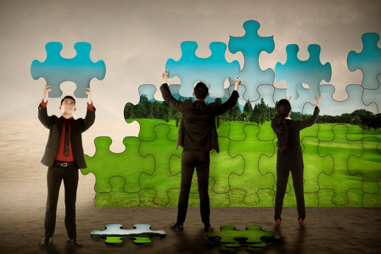 Business teamwork assembling puzzle pieces create green environtment. Green industry concept